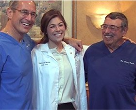 All three Dr. Brooks smiling togetehr