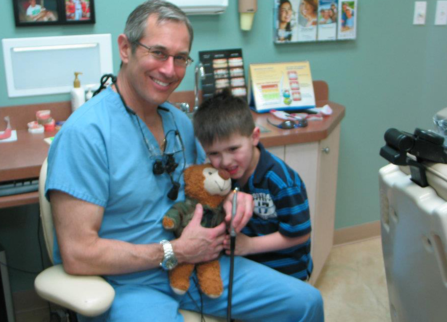 Dr. Brooks working with young boy