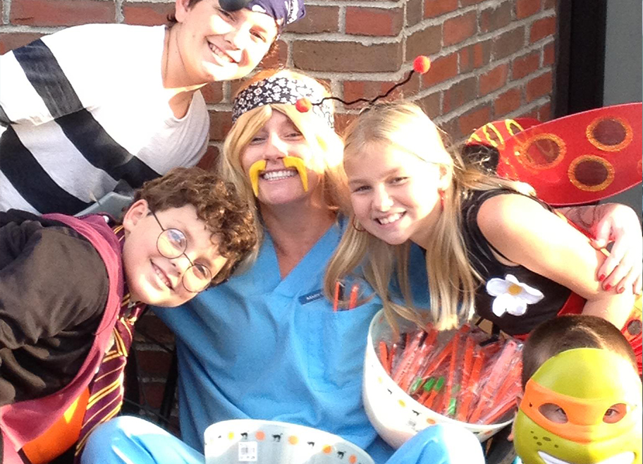 Dentist and kids dressed up for Halloween