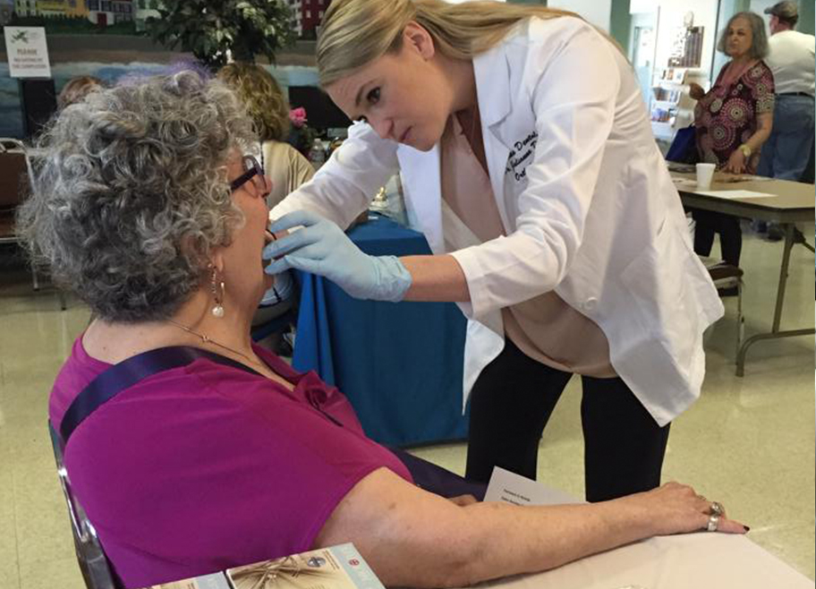 Dr. Stephanie Brooks working with older female patient