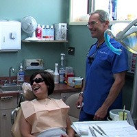 Dr. Brooks and patient laughing together