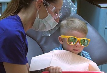 Child working with dental hygienist