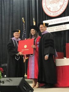 Dr. Stephanie receiving degree