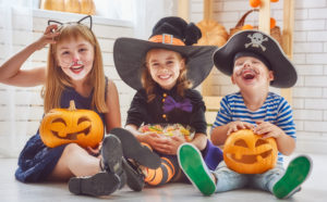 Smiling children in Halloween costumes