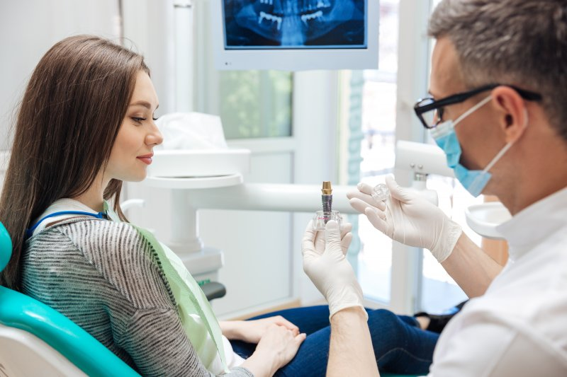 Dentist explaining dental implants in Revere