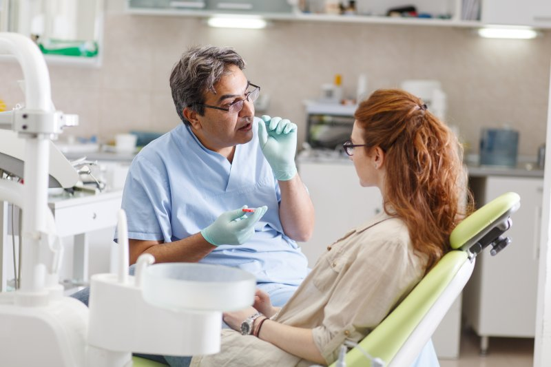 Dentist talking to patient about implant alternatives
